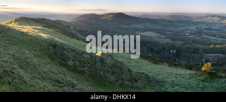 A panoramic photograph taken at sunrise from Pinnacle Hill, Malvern Hills, looking South towards Black Hill, British - Stock Photo