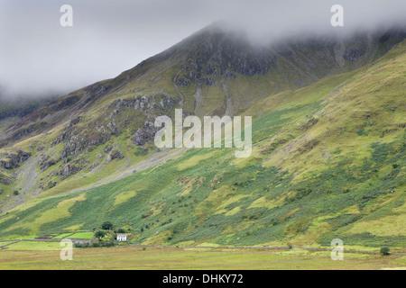 Pentre Farm, Nant Ffrancon, Bethesda is dwarfed again Foel Goch - Stock Photo
