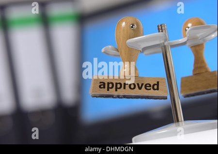 rubber stamp marked with approved - Stock Photo
