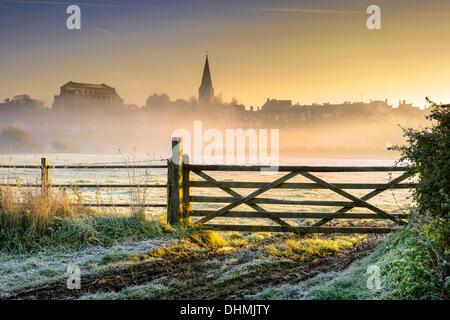 Malmesbury, Wiltshire, UK  . 13th Nov, 2013. Sunrise over the Wiltshire hillside town of Malmesbury lights up the - Stock Photo