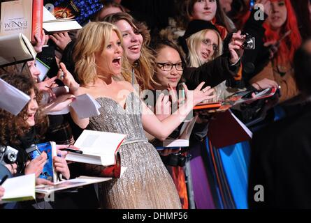 Berlin, Germany. 12th Nov, 2013. US actress Elizabeth Banks poses with fans after her arrival at the German premiere - Stock Photo