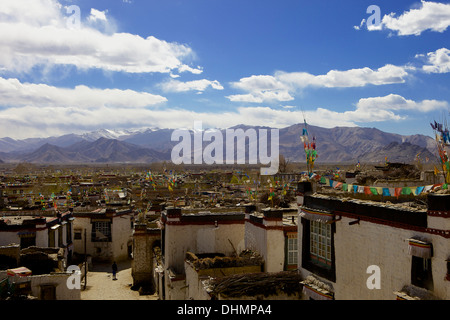 Traditional Tibetan houses in old village area, Gyantse (Gyangtse) with mountain range in background, Tibet, China, - Stock Photo