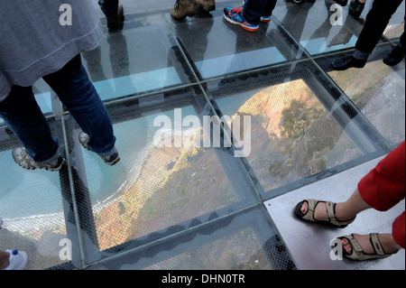 Madeira Portugal.Tourists standing on the glass floor viewing platform at Cabo Girao one of Europes highest sea - Stock Photo