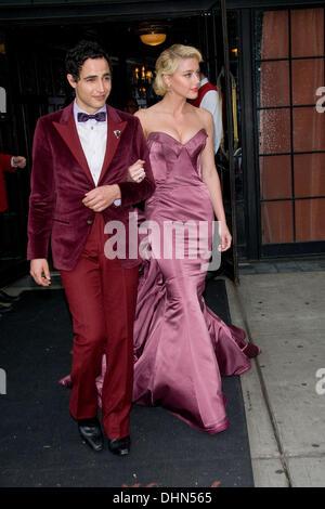 Zac Posen and Amber Heard leave their hotel New York City, USA - 07.05.12 - Stock Photo