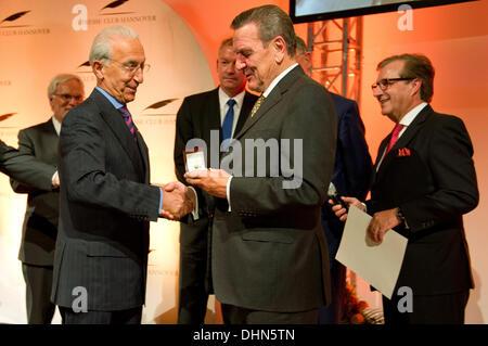 Hanover, Germany. 12th Nov, 2013. Former German Chancellor Gerhard Schroeder (SPD, 2nd R) awards brain surgeon Madjid - Stock Photo
