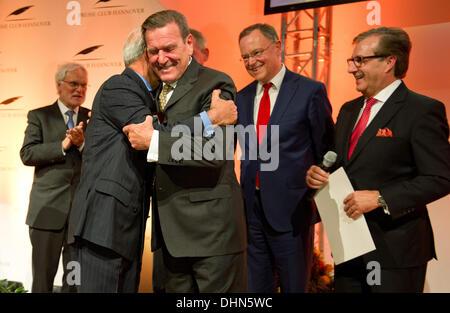 Hanover, Germany. 12th Nov, 2013. Former German Chancellor Gerhard Schroeder (SPD, 3rd L) awards brain surgeon Madjid - Stock Photo