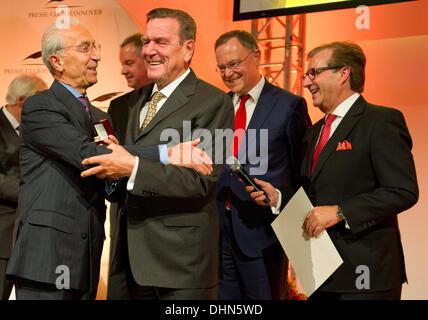 Hanover, Germany. 12th Nov, 2013. Former German Chancellor Gerhard Schroeder (SPD, 2nd L) awards brain surgeon Madjid - Stock Photo