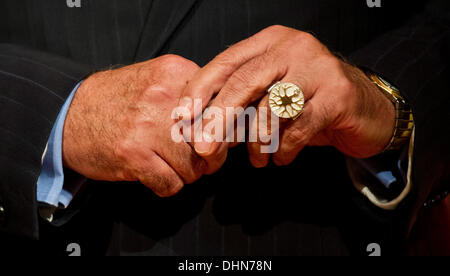 Hanover, Germany. 12th Nov, 2013. Brain surgeon Madjid Samii carries the Leibniz-Ring 2013 award on his finger, - Stock Photo