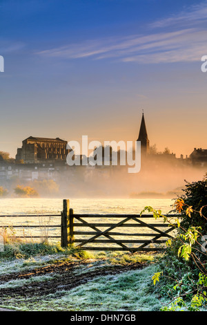 Sunrise over the Wiltshire hillside town of Malmesbury lights up the first frost in early November. - Stock Photo