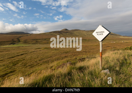 Inchkinloch, Scotland. Picturesque view of a passing place road sign on the single track A836 within the Inchkinloch - Stock Photo