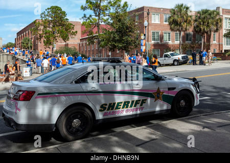 Police car parked in front of Ben Hill Griffin stadium on game day in the University of Florida in Gainesville, - Stock Photo