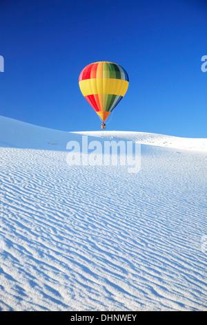 Hot air balloon over dunes, White Sands Hot Air Balloon Invitational, White Sands National Monument, Alamogordo, - Stock Photo
