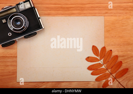 Vintage Photo Camera and Paper - Stock Photo