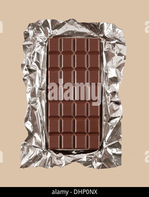 Chocolate candy bar with foil wrapper unwrapped - Stock Photo