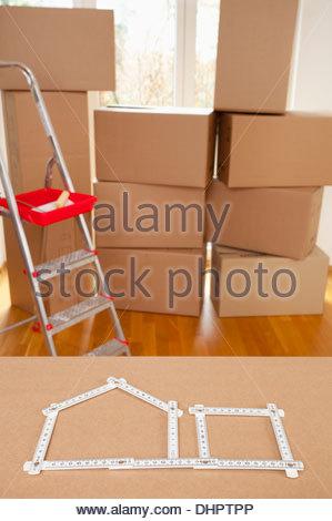 Cardboard box room ruler nobody empty house model - Stock Photo