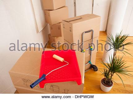 Cardboard box decorating renovating paint pot tray - Stock Photo