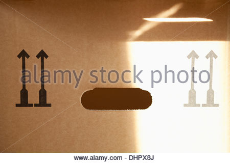 Close up detail of Cardboard box handle grip paper - Stock Photo