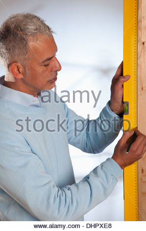 Senior Architect man engineer using spirit level - Stock Photo