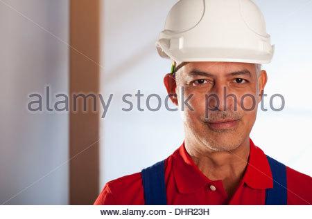 Older Construction worker helmet hard hat portrait - Stock Photo