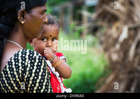 Indian Mother And Baby Girl Waiting At The Sri Sathya Sai Baba