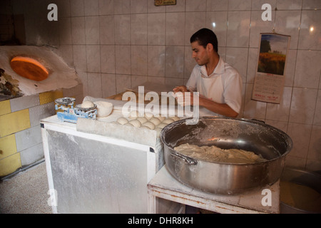 A bakery shop with traditional ovens - Stock Photo