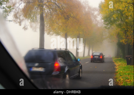 Traffic on an alley in autumn - Stock Photo