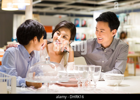 Cheerful family face to face talking - Stock Photo