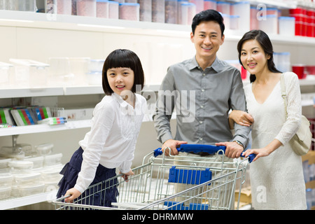 Happy family shopping in supermarket - Stock Photo