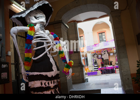 Skeleton decorations for the Day of the Dead festival known in spanish as Día de Muertos in Oaxaca, Mexico. - Stock Photo