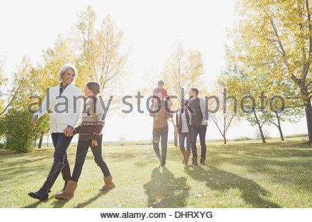 Multi-generation family walking in park - Stock Photo