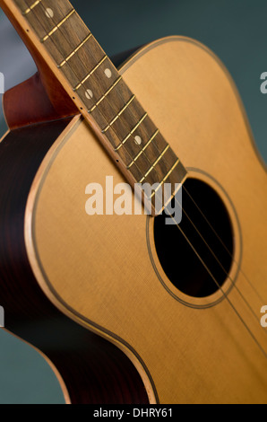 Tenor Guitar with green background Stock Photo