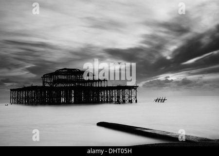 Black and white image of West Pier, Brighton, at sunset - Stock Photo