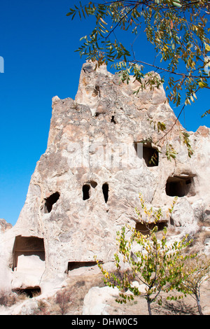 The valley of the rock-cut churches at the Goreme open-air museum in Cappadocia, Central Anatolia, Turkey. - Stock Photo