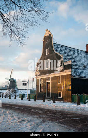 Netherlands, Zaanse Schans, Zaandam, Open air tourist attraction. Windmills and houses. Winter,  miller with clogs - Stock Photo