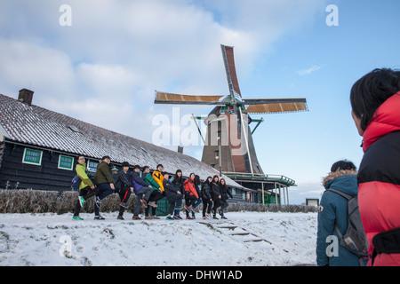 Netherlands, Zaanse Schans near Zaandam, Open air tourist attraction with windmills and houses. Winter. Group of - Stock Photo