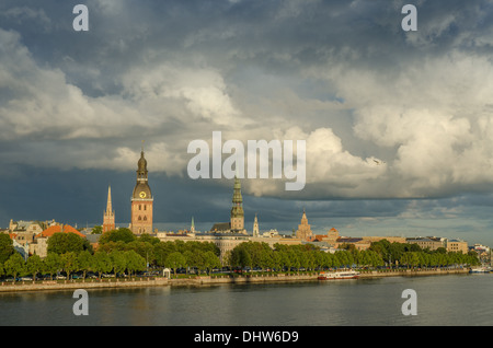view of the sunset lit cathedral church and st. peter tower of old riga latvia after rain - Stock Photo