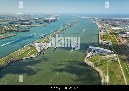 Holland, Rotterdam, Port. Maeslant barrier, Maeslantkering. Storm surge barrier Delta works. Oil storage chemical - Stock Photo
