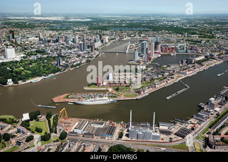 Netherlands, Rotterdam, View on city center. Foreground historic ship called MS Rotterdam. Aerial - Stock Photo