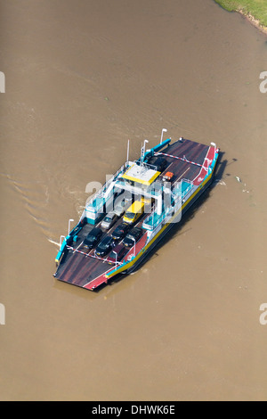 Netherlands, Wijk bij Duurstede, Car ferry crossing Nederrijn river. Aerial - Stock Photo