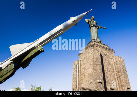 Rocket missile, Mother Armenia statue and military museum at Victory Park, Yerevan, Armenia - Stock Photo