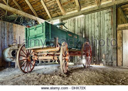Wagon in barn, Mennonite Heritage Village, Steinbach, Manitoba, Canada - Stock Photo