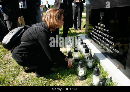 Lamps being laid at memorial stone in the newly re built and reconsecrated Jewish cemetery in Brzostek south-eastern - Stock Photo