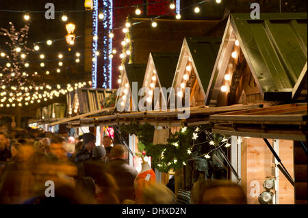 Manchester, UK. 15th November, 2013. Thousands of visitors flock to the 300 Christmas Market stalls spread across - Stock Photo