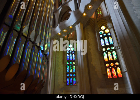 Stain glass window reflections on organ pipes - Sagrada Familia : Gaudi's Cathedral - Stock Photo