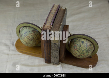 old vintage 1800 1900 book books globe stand stands conceptual historic historical library vintage read reading - Stock Photo