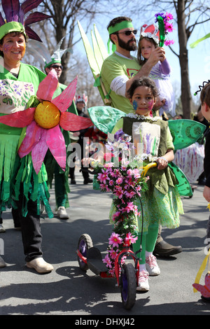 A young family dressed as flowers at the May Day parade in Minneapolis. - Stock Photo
