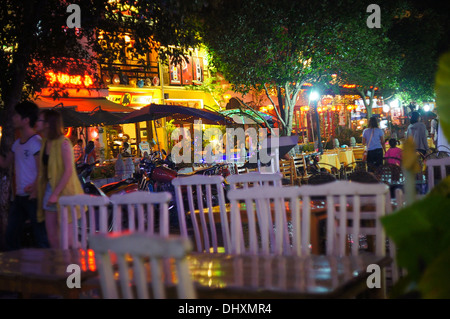Scene from a tourist street by night in Yangshuo, China - Stock Photo