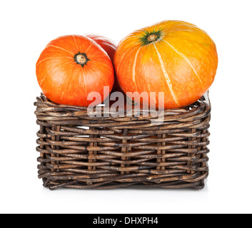 Ripe small pumpkins in basket. Isolated on white background - Stock Photo