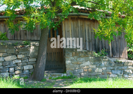 Wooden chalet built on the hill of Tsarevets Fortress & Patriachal Cathedral of the Holy Ascension of God Veliko - Stock Photo