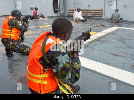 DJIBOUTI, Djibouti (Nov. 14, 2013) - Uganda People's Defence Force members guard simulated detainees on a vessel - Stock Photo